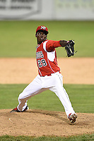 Batavia Muckdogs pitcher Juancito Martinez (29) delivers a pitch during a game against the Jamestown Jammers on July 7, 2014 at Dwyer Stadium in Batavia, New York.  Batavia defeated Jamestown 9-2.  (Mike Janes/Four Seam Images)