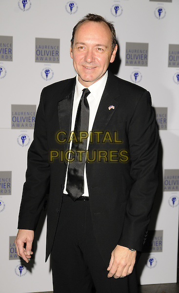 KEVIN SPACEY.Laurence Olivier Awards at the Grosvenor House Hotel, Park Lane, London, England..March 8th 2009.half length black jacket tuxedo suit tie .CAP/CAN.©Can Nguyen/Capital Pictures.