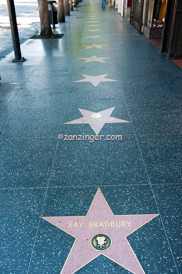 Ray Bradbury, Hollywood Walk of Fame, Celebrity Stars, American fantasy, horror, science fiction, and mystery writer, coral-pink terrazzo five-point star rimmed with brass, inlaid into a charcoal-colored terrazzo background. In the upper portion of the pink star field,  round inlaid brass emblem indicates the category