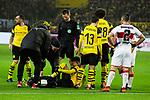 09.03.2019, Signal Iduna Park, Dortmund, GER, 1.FBL, Borussia Dortmund vs VfB Stuttgart, DFL REGULATIONS PROHIBIT ANY USE OF PHOTOGRAPHS AS IMAGE SEQUENCES AND/OR QUASI-VIDEO<br /> <br /> im Bild   picture shows:<br /> Schiedsrichter   Referee Benjamin Cortus, Axel Witsel (Borussia Dortmund #28) und Raphael Guerreiro (Borussia Dortmund #13) sind beim verletzen Jadon Sancho (Borussia Dortmund #7), <br /> <br /> Foto &copy; nordphoto / Rauch