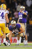 Sept. 5, 2009; Seattle, WA, USA; Washington Huskies quarterback (10) Jake Locker calls a play behind center (65) Ryan Tolar against the LSU Tigers at Husky Stadium. Mandatory Credit: Mark J. Rebilas-