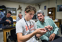NWA Democrat-Gazette/BEN GOFF @NWABENGOFF<br /> Will Rusch, a junior, ties a fly with help from Russ Tonkinson with the Bella Vista Fly Tyers Club Wednesday, Oct. 9, 2019, during an outdoor education class at Bentonville High School. Members of the Bella Vista Fly Tyers volunteer to teach fly tying each semester at the school. The students have been learning about fly fishing and plan to take a field trip to Roaring River State Park later in the month to put the skills into practice.
