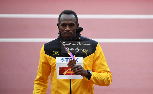 Usain Bolt (JAM) with his bronze medal from the mens 100m. IAAF world athletics championships. London Olympic stadium. Queen Elizabeth Olympic park. Stratford. London. UK. 06/08/2017. ~ MANDATORY CREDIT Garry Bowden/SIPPA - NO UNAUTHORISED USE - +44 7837 394578