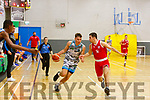 Garveys Rap Buivydas been well guarded by Chris Looney of UCC in the U20 Basketball league in the Tralee Sports Complex on Sunday