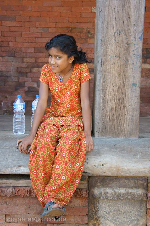 Newar girl resting at Durbar Square in Bhaktapur, Nepal
