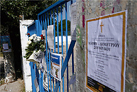 "Pictured: A funeral announcement is posted next to flowers and tributes left at the gate of the 6th primary School in Acharnes, Athens, Greece. Saturday 10 June 2017<br /> Re: An 11 year old boy has been shot dead by a ""stray bullet"" during a school celebration in Acharnes (Menidi) area, in the outskirts of Athens, Greece.<br /> Marios Dimitrios Souloukos ""complained to his mum"" who works as a teacher at the 6th Primary School of Acharnes that he was feeling unwell, he then collapsed with blood pouring out from the top of his head.<br /> His mum tried to revive him assisted by other teachers while his schoolmates who were reportedly upset, were hurriedly removed by their parents.<br /> According to locals an ambulance arrived 25 minutes late.<br /> Hundreds of police officers have been deployed in the area and have raided many properties.<br /> Shells matching the fatal bullet which hit the boy on the top of his head were found in a house yard nearby.<br /> Local people reported hearing shots being fired at a nearby Romany Gypsy camp before the fatal incident.<br /> The area has been plagued with criminality during the last few years."