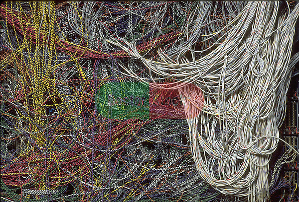 large tangle of wiring, metaphor for nervous system or brain