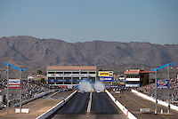 Feb 21, 2014; Chandler, AZ, USA; Overall view of Wild Horse Motorsports Park as NHRA funny car driver John Force (left) does a burnout alongside Matt Hagan qualifying for the Carquest Auto Parts Nationals. Mandatory Credit: Mark J. Rebilas-USA TODAY Sports