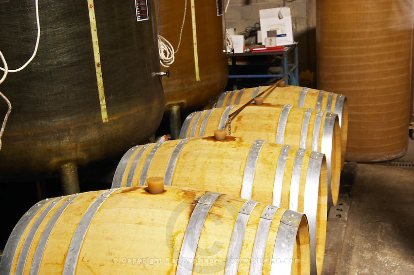 Domaine de Terre Megere, Cournonsec, Montpellier. Gres de Montpellier. Languedoc. Barrel cellar. Batonnage, stirring of the lees with a stave. France. Europe.