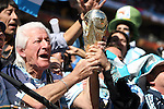 17 JUN 2010:  Argentina fans clutch World Cup trophy in the stands.  The Argentina National Team defeated the South Korea National Team 4-1 at Soccer City Stadium in Johannesburg, South Africa in a 2010 FIFA World Cup Group E match.