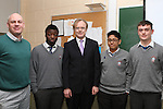 Teacher Sean Kelly with Students Mel Smith, Stephen Paclibar and Conor Farrell with Noel Farrell (centre) as the Irish EU Official heads back to his old school to talk to the pupils at St.Josephs...(Photo credit should read Jenny Matthews/NEWSFILE)...