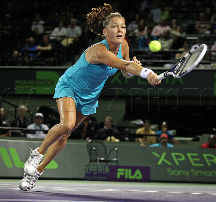 Agnieszka Radwanska of Poland chases the ball during match against Marion Bartoli of France at Sony Ericsson Open on Key Biscayne on Thursday, March 29, 2012.