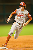 Erich Weiss #6 of the Texas Longhorns rounds third base in the top of the 9th inning against the Tennessee Volunteers at Minute Maid Park on March 3, 2012 in Houston, Texas.  The Volunteers defeated the Longhorns 5-4.  Brian Westerholt / Four Seam Images