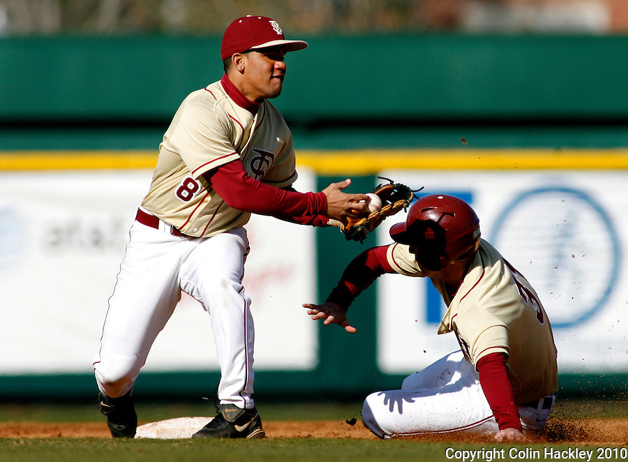 TALLAHASSEE, FL 2/13/10-FSU-BSB FANDAY10 CH35-Florida State's Devon Travis bobbles a throw at second as Kevin Jackson slides safe during Fan Day Scrimmage action Saturday in Tallahassee...COLIN HACKLEY PHOTO