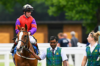 Winner of The British Stallion Studs EBF Margadale Fillies' Handicap Burgonet ridden by Franny Norton and trained by Mark Johnston is led into the winners enclosure during Afternoon Racing at Salisbury Racecourse on 12th June 2018