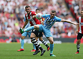 28th May 2018, Wembley Stadium, London, England;  EFL League 2 football, playoff final, Coventry City versus Exeter City; Jordan Shipley of Coventry City blocks Pierce Sweeney of Exeter City from the ball