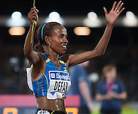 Ethiopia's Meseret Defar celebrates after running 3000m in 8:30.29 at the IAAF Diamond League meeting in Stockholm.