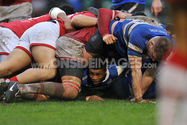 Kyle Eastmond is trapped at the bottom of a ruck. Amlin Challenge Cup match, between Bath Rugby and Agen on January 12, 2013 at the Recreation Ground in Bath, England. Photo by: Patrick Khachfe / Onside Images