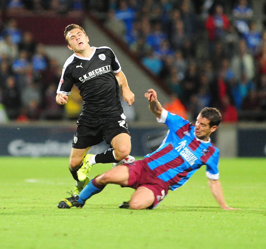 Barnsley's Josh Scowen vies for possession with Scunthorpe United's Sean McAllister<br /> <br /> Photographer Andrew Vaughan/CameraSport<br /> <br /> Football - Capital One Cup First Round - Scunthorpe United v Barnsley - Tuesday 11th August 2015 - Glanford Park - Scunthorpe<br />  <br /> &copy; CameraSport - 43 Linden Ave. Countesthorpe. Leicester. England. LE8 5PG - Tel: +44 (0) 116 277 4147 - admin@camerasport.com - www.camerasport.com