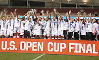 Players and coaches of D.C. United celebrate their win with the trophy over Real Salt Lake at the U.S. Open Cup Final on October  1, 2013 at Rio Tinto Stadium in Sandy, Utah. DC United beat Real Salt Lake 1-0 to win the championship.