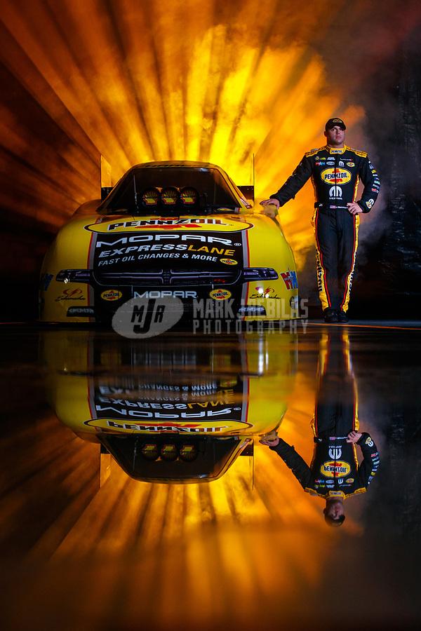 Jan 11, 2018; Brownsburg, IN, USA; NHRA funny car driver Matt Hagan poses for a portrait during a photo shoot at Don Schumacher Racing. Mandatory Credit: Mark J. Rebilas-USA TODAY Sports