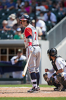 Brandon Snyder (7) of the Gwinnett Braves looks to the third base coach for the signs during the game against the Charlotte Knights at BB&T BallPark on May 22, 2016 in Charlotte, North Carolina.  The Knights defeated the Braves 9-8 in 11 innings.  (Brian Westerholt/Four Seam Images)