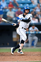 Asheville Tourists right fielder Manny Melendez (19) swings at a pitch during a game against the Augusta GreenJackets at McCormick Field on July 16, 2017 in Asheville, North Carolina. The Tourists defeated the GreenJackets 12-3. (Tony Farlow/Four Seam Images)