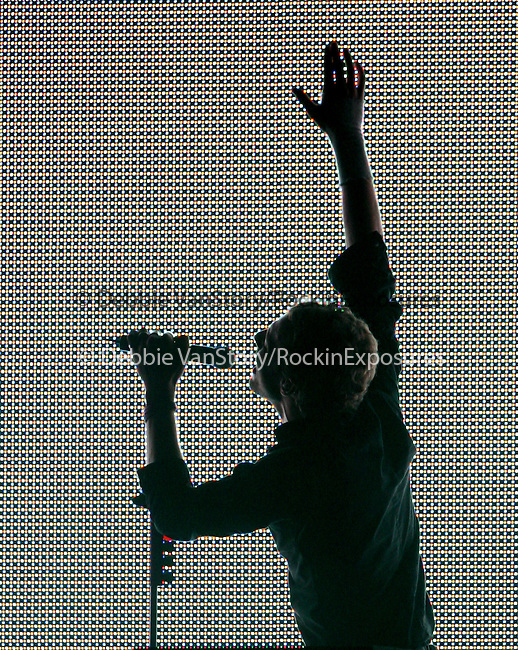 "Chris Martin of Coldplay performs live at Verizon Wireless during their ""Twisted Logic Tour"" in support of their new album ""X&Y"" in Irvine,California on August 20,2005.(Pictured:Coldplay,Chris Martin ). Copyright 2005 by RockinExposures"