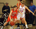SIOUX FALLS, SD - JANUARY 22:  Kelsey Knecht #30 from Washington looks to drive past Shelby Merritt #22 from Lincoln in the first half of their game Tuesday night at Lincoln. (Photo by Dave Eggen/Inertia)