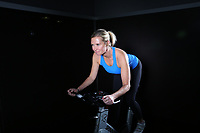 Dec. 14. 2018. Carslbad, CA. USA| Julie on a cycle at Carlsbad Fitness Center.  |Photos by Jamie Scott Lytle. Copyright.