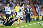 Luka Modric of Real Madrid (top) fights for the ball with Cristian Tello Herrera of Real Betis (bottom) during the La Liga 2017-18 match between Real Madrid and Real Betis at Estadio Santiago Bernabeu on 20 September 2017 in Madrid, Spain. Photo by Diego Gonzalez / Power Sport Images