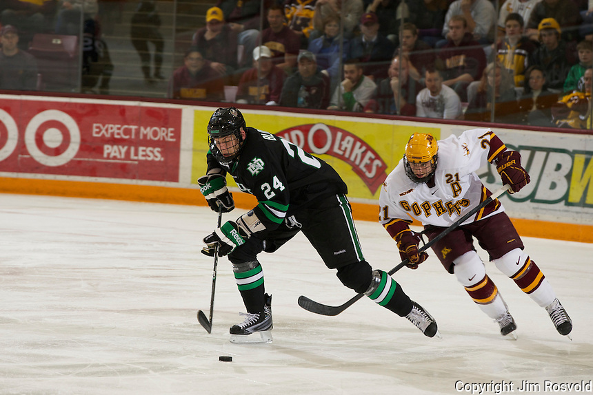 6 Nov 11: Ben Blood (North Dakota - 24), Jake Hansen (Minnesota - 21) The University of Minnesota Golden Gophers host the University of North Dakota Fighting Sioux in a WCHA matchup at Mariucci Arena in Minneapolis, MN.