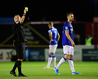 Everton's Jordan Pickford (out of picture) is shown a yellow card by referee Darren Bond<br /> <br /> Photographer Chris Vaughan/CameraSport<br /> <br /> The Carabao Cup Second Round - Lincoln City v Everton - Wednesday 28th August 2019 - Sincil Bank - Lincoln<br />  <br /> World Copyright © 2019 CameraSport. All rights reserved. 43 Linden Ave. Countesthorpe. Leicester. England. LE8 5PG - Tel: +44 (0) 116 277 4147 - admin@camerasport.com - www.camerasport.com
