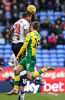 Bolton Wanderers' Josh Magennis competing with Norwich City's Tom Trybull  <br /> <br /> Photographer Andrew Kearns/CameraSport<br /> <br /> The EFL Sky Bet Championship - Bolton Wanderers v Norwich City - Saturday 16th February 2019 - University of Bolton Stadium - Bolton<br /> <br /> World Copyright © 2019 CameraSport. All rights reserved. 43 Linden Ave. Countesthorpe. Leicester. England. LE8 5PG - Tel: +44 (0) 116 277 4147 - admin@camerasport.com - www.camerasport.com