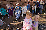 """Aug 9, 2008 -- COLORADO CITY, AZ: JOSEPH JESSOP, 86, patriarch of the Jessop family, polygamists and members of FLDS in Colorado City, AZ, surrounded by some of his great grandchildren during a picnic near their home in Colorado City, AZ. Colorado City and neighboring town of Hildale, UT, are home to the Fundamentalist Church of Jesus Christ of Latter Day Saints (FLDS) which split from the mainstream Church of Jesus Christ of Latter Day Saints (Mormons) after the Mormons banned plural marriage (polygamy) in 1890 so that Utah could gain statehood into the United States. The FLDS Prophet (leader), Warren Jeffs, has been convicted in Utah of """"rape as an accomplice"""" for arranging the marriage of teenage girl to her cousin and is currently on trial for similar, those less serious, charges in Arizona. After Texas child protection authorities raided the Yearning for Zion Ranch, (the FLDS compound in Eldorado, TX) many members of the FLDS community in Colorado City/Hildale fear either Arizona or Utah authorities could raid their homes in the same way. Older members of the community still remember the Short Creek Raid of 1953 when Arizona authorities using National Guard troops, raided the community, arresting the men and placing women and children in """"protective"""" custody. After two years in foster care, the women and children returned to their homes. After the raid, the FLDS Church eliminated any connection to the """"Short Creek raid"""" by renaming their town Colorado City in Arizona and Hildale in Utah. A member of the Jessop family weeds the community corn plot in Colorado City, AZ. The Jessops are a polygamous family and members of the FLDS. Photo by Jack Kurtz / ZUMA Press"""
