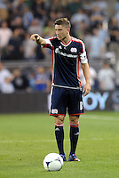 Chris Tierney (8) New England gives directions for a free kick... Sporting Kansas City defeated New England Revolution 3-0 at LIVESTRONG Sporting Park, Kansas City, Kansas.