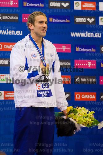 Jonatan Kopelev of Israel celebrates his victory in the Men's 50m Backstroke of the 31th European Swimming Championships in Debrecen, Hungary on May 23, 2012. ATTILA VOLGYI