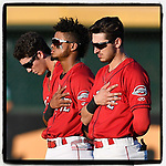 Greenville Drive outfielders Jarren Duran, Kervin Suarez and Jordan Wren stand for the National Anthem before a game against the Lexington Legends on Saturday, September 1, 2018, at Fluor Field at the West End in Greenville, South Carolina. Greenville won, 9-6. (Tom Priddy/Four Seam Images)
