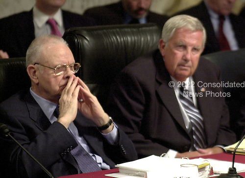 Washington, DC - April 8, 2004 -- 9/11 Commission Vice Chairman Lee Hamilton, left, and Fred Fielding, right, listen to the testimony of Doctor Condoleezza Rice, National Security Advisor, before the commission in Washington, D.C. on April 8, 2004.<br /> Credit: Ron Sachs / CNP<br /> [RESTRICTION: No New York Metro or other Newspapers within a 75 mile radius of New York City]