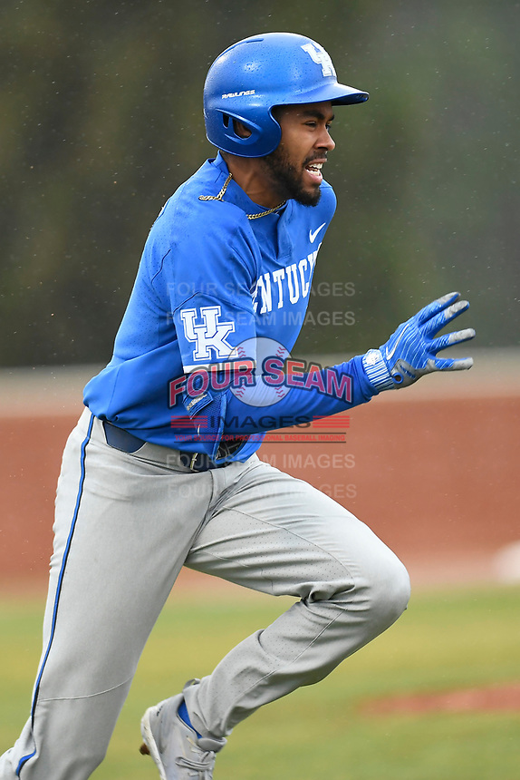 Left fielder Tristan Pompey (6) of the Kentucky Wildcats runs to first base in a game in the rain against the University of South Carolina Upstate Spartans on Saturday, February 17, 2018, at Cleveland S. Harley Park in Spartanburg, South Carolina. Kentucky won, 6-5, in 10 innings. (Tom Priddy/Four Seam Images)