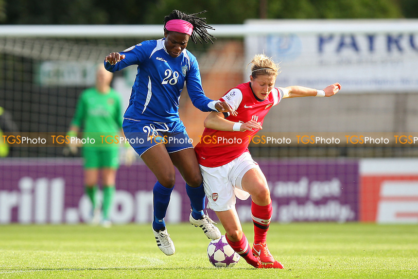 Ellen White of Arsenal tangles with Ifeanyichukwu Chiejine - Arsenal Ladies vs WFC SSHVSM Kairat - UEFA Womens Champions League Round of 32 2nd Leg Football at Meadow Par, Boreham Wood FC - 17/10/13 - MANDATORY CREDIT: Gavin Ellis/TGSPHOTO - Self billing applies where appropriate - 0845 094 6026 - contact@tgsphoto.co.uk - NO UNPAID USE