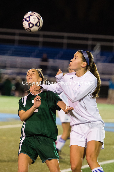 MIDDLETOWN, CT - 16 November 2015-111615EC05-- Holy Cross' Madison Bushka heads the ball next to Old Lyme's Sam Lee in Middletown Monday night. Erin Covey Republican-American.