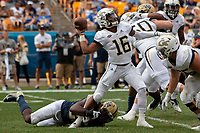 Georgia Tech Yellow Jackets quarterback TaQuon Marshall (16) tries to pass the ball despite a Pitt defender holding on to his leg. The Pitt Panthers football team defeated the Georgia Tech Yellow Jackets 24-19 on September 15, 2018 at Heinz Field in Pittsburgh, Pennsylvania.