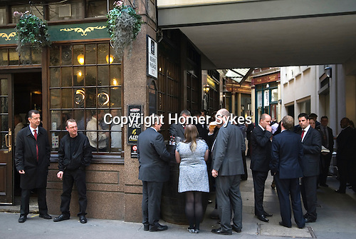 City office business men women office workers lunch time drink. City of London EC3 UK.