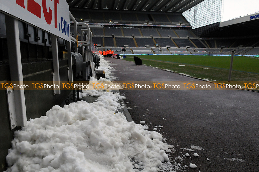 Snow has been cleared from the St James Park pitch before Newcastle United vs Reading - Newcastle United vs Reading - Barclays Premier League Football at St James Park, Newcastle upon Tyne - 19/01/13 - MANDATORY CREDIT: Steven White/TGSPHOTO - Self billing applies where appropriate - 0845 094 6026 - contact@tgsphoto.co.uk - NO UNPAID USE.
