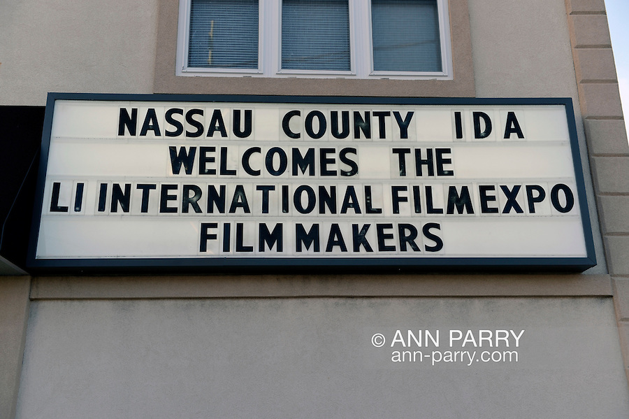 Bellmore, New York, United States. July 10, 2015. The marquee sign sign at Bellmore Movies has message Nassau County IDA Welcomes The LI International Film Expo Filmmakers, during of the Long Island International Film Expo. LIIFE events, including screenings, panels, and ceremonies, span from July 8 through July 16.