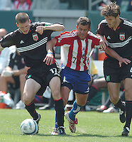 D.C. United Joshua Gros and Chivas' Ramon Ramirez battled for the ball at the Home Depot Center, in Carson, California, Saturday, April 2, 2005.