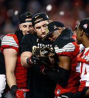 Ohio State Buckeyes defensive lineman Joey Bosa (97) and Ohio State Buckeyes safety Tyvis Powell (23) celebrate beating Oregon Ducks 42-20 in College Football Playoff Championship game at AT&T Stadium in Arlington, Texas on January 12, 2015.  (Dispatch photo by Kyle Robertson)