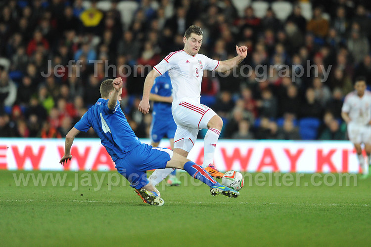 Sam Vokes of Wales and Kari Arnason of Iceland battle for the ball. Cardiff City Stadium, Cardiff, Wales, Wednesday 5th March 2014. The Football Association of Wales - Vauxhall International Friendly - Wales v Iceland. Pictures by Jeff Thomas Photography - www.jaypics.photoshelter.com - Contact: thomastwotimes@live.co.uk - 07837 386244