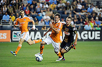 Hunter Freeman (21) of the Houston Dynamo is chased by Jack McInerney (19) of the Philadelphia Union. The Philadelphia Union and the Houston Dynamo played to a 1-1 tie during a Major League Soccer (MLS) match at PPL Park in Chester, PA, on August 6, 2011.